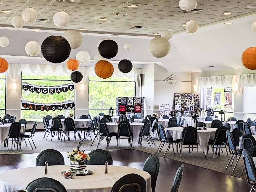 Photos of a graduation party at Mystic Creek. The room is decorated for the occasion and the golf course grounds can be seen through the windows.